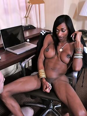 Ebony Ts Natalia Coxxx giving a blow-job to her slave boy